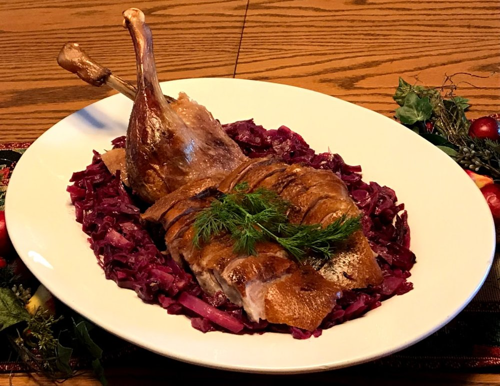 Roast goose on a bed of braised red cabbage.
