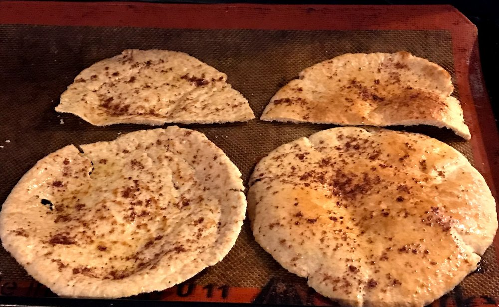 Pita bread, sliced in half through the middle of each round and oven-ready.