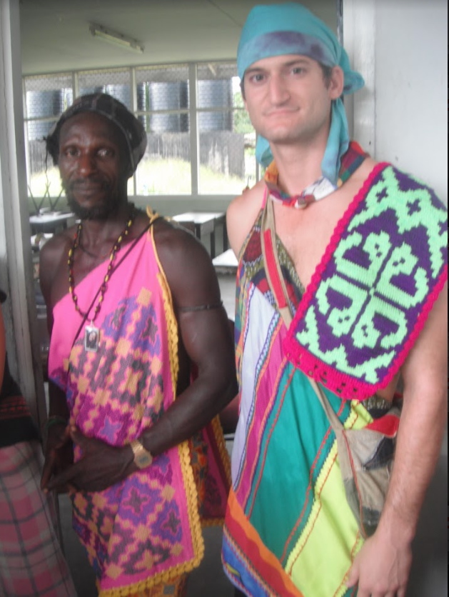 Evan pictured with his local counterpart, Edje Doekoe, during a community celebration after a successful infrastructure project