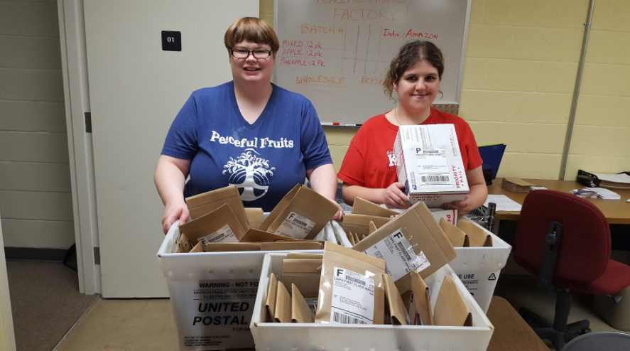 Here are team members Lindsey and Crystal with snacks ready for shipment!