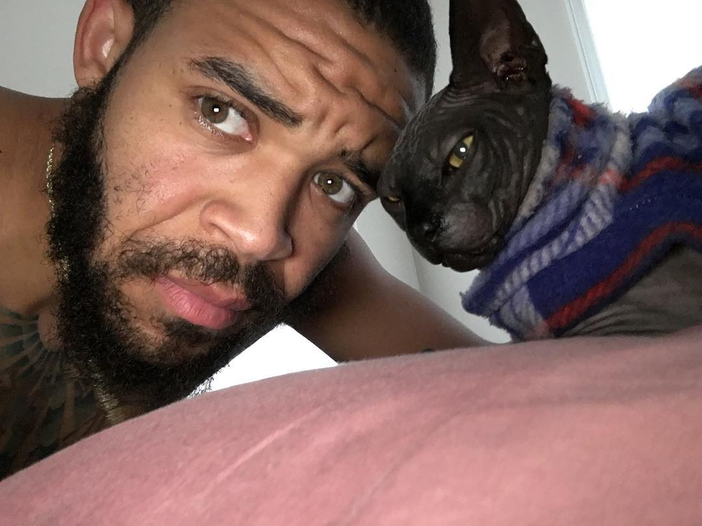 Raja the cat with owner JaVale McGee / Image Credit: ESPN