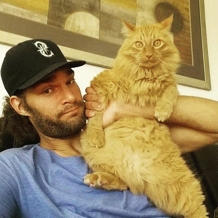 Prince Edward the cat with owner Robin Lopez / Image Credit: ESPN