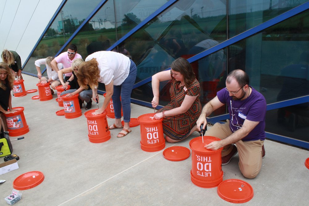 Attendees creating their own take-home compost buckets.