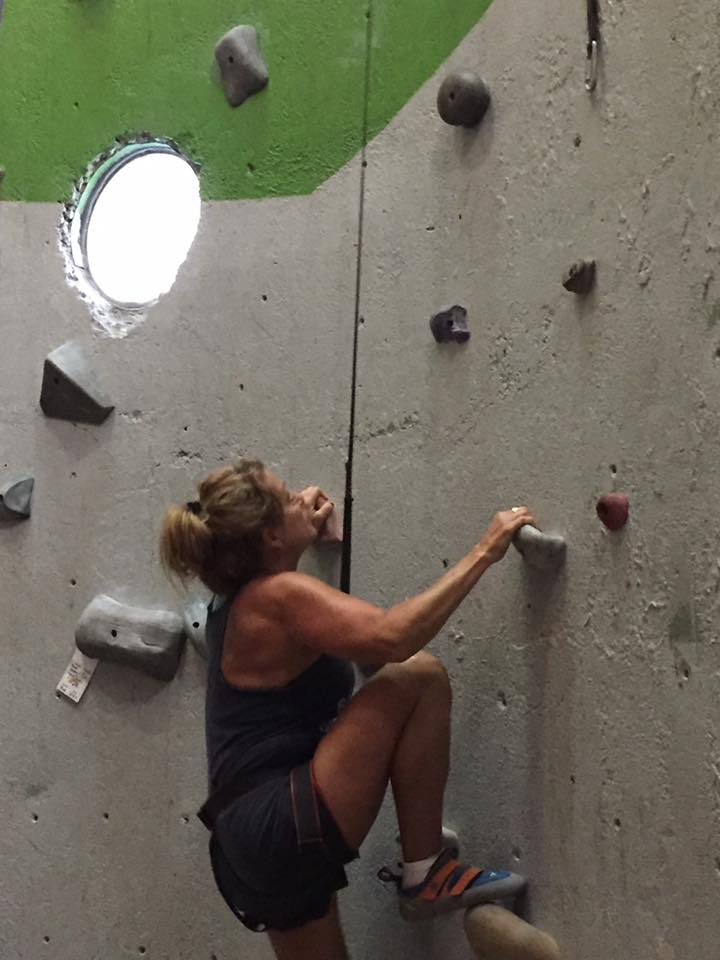 KOB Board member, Monti Smith, on a climbing wall at ClimbUP Gym in OKC.