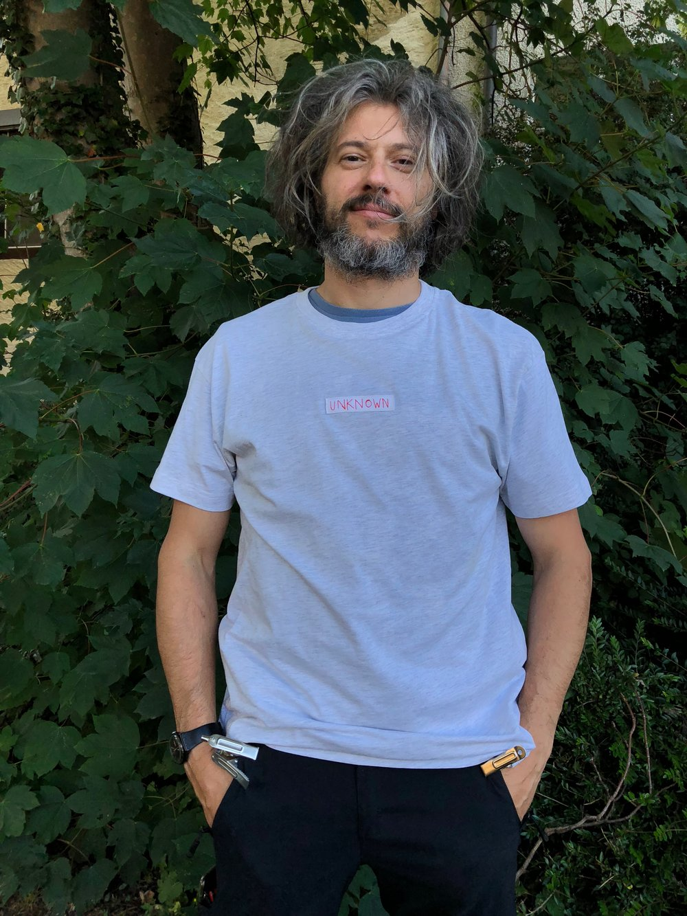 DESCONOCIDA/UNKNOWN –  LIGHT GREY MELANGE  PROTEST T- SHIRTS — SIZE S, M, L and XL
