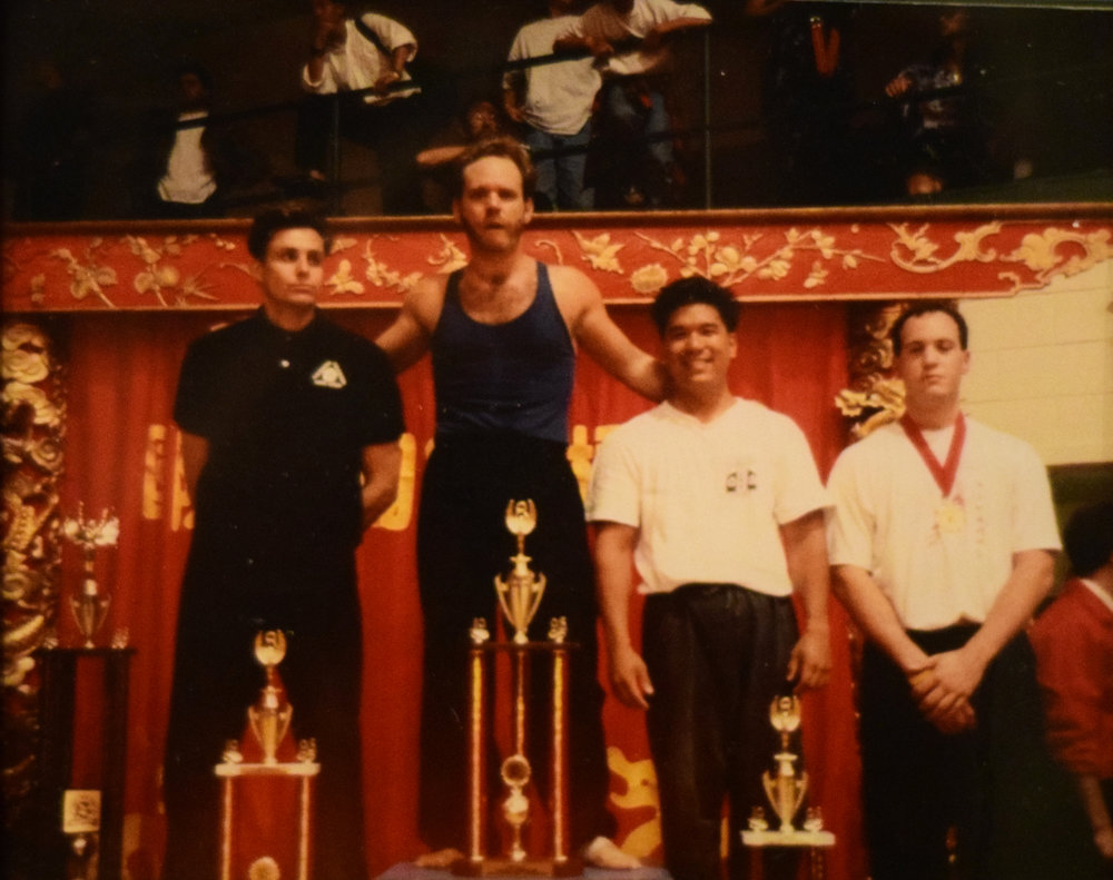 Professor Brian Tufts (Second from the left) taking his 1st place at the Tiger Balm International Chinese Martial Arts Championship