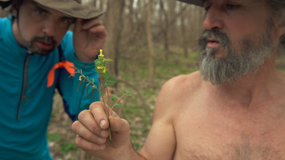 John Ruskey explores fauna on a nature walk, with paddler John Abnet onlooking. Photo Credit: Chris Battaglia.