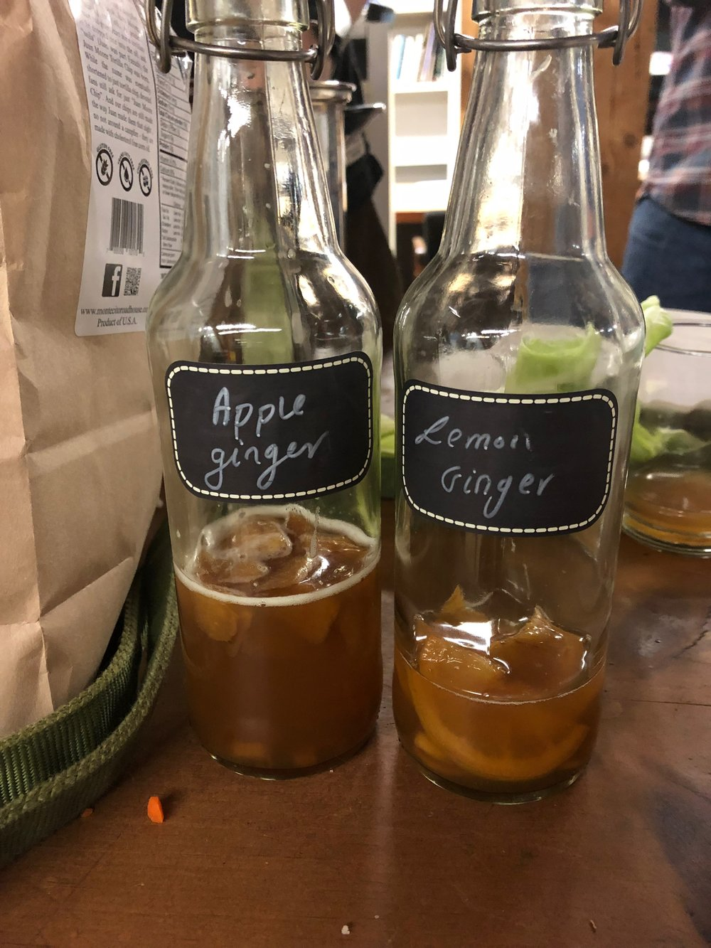 Bottles of homemade Kombucha Maria brought in for everyone to taste.