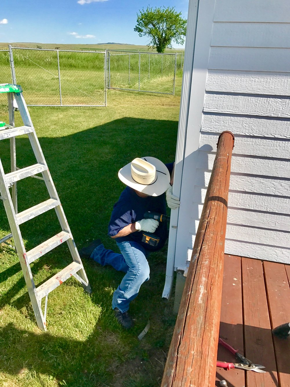Brian Biggers Attaches Rain Gutter on the HPM Store.jpg