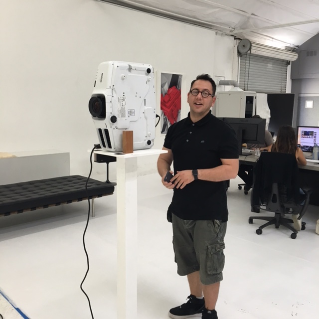 Refik-w-projector-in-studio.jpg