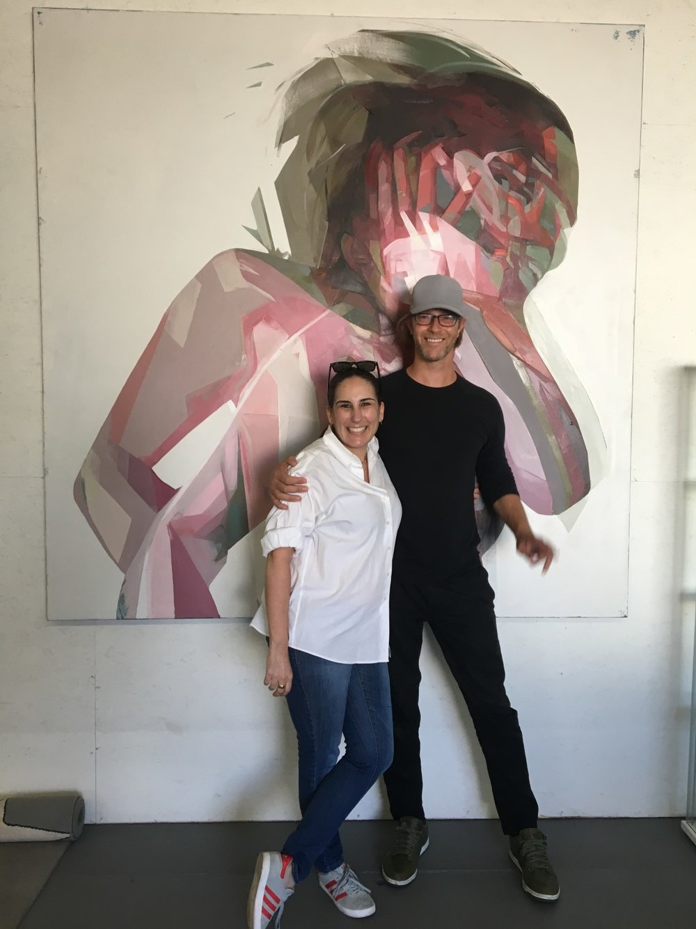 Niio's Margo Spiritus with the 14th Factory LA's founder, Simon Birch in front of one of his paintings.
