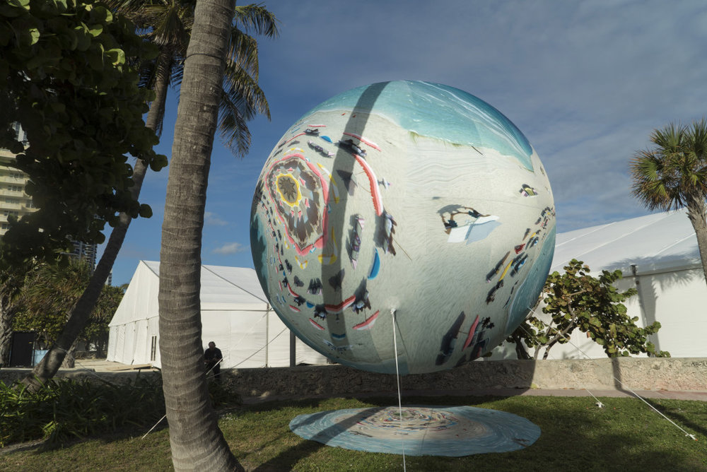 Adrift on Titan (Miami Marbles series) at PULSE Contemporary Art Fair Miami Beach, FL, 2016. The first PULSE PROJECTS Special Commission, Miami Marbles is a mixed augmented reality (AR) installation combining AR components, via a custom app, with nine physical helium-filled spheres—ranging from seven to 16 feet in diameter— printed with digitally manipulated footage of Miami Beach; Courtesy of Anne Spalter.