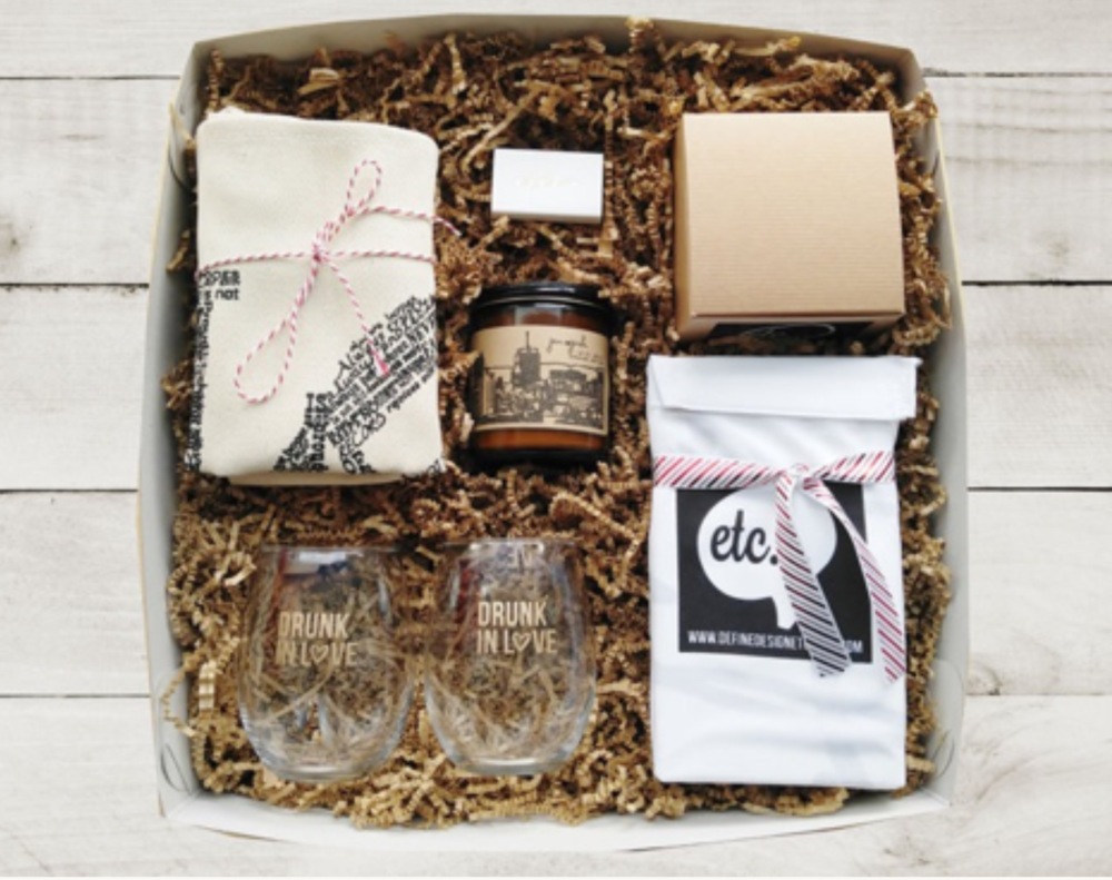 Gift Box - Not sure what to get? Then get this perfectly curated wedding gift box by Define Design Etc. The box includes everything from Mr and Mrs pillowcases, stemless wine glasses, a tote bag, card and a soy candle and matches.
