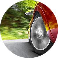 car-wheel-on-road-closeup.png