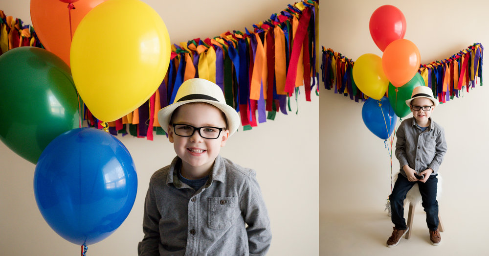 Five year old boy in hat with balloons during indoor photo session in Cedar Rapids, Iowa.