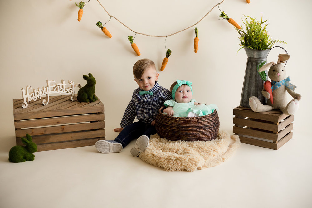 Two year old boy and five month old girl sitting for picture during Easter Mini Session in Cedar Rapids, Iowa.