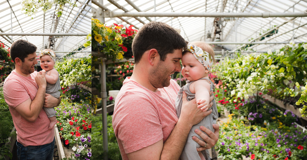 A father with his baby girl in Pierson's Greenhouse in Cedar Rapids.
