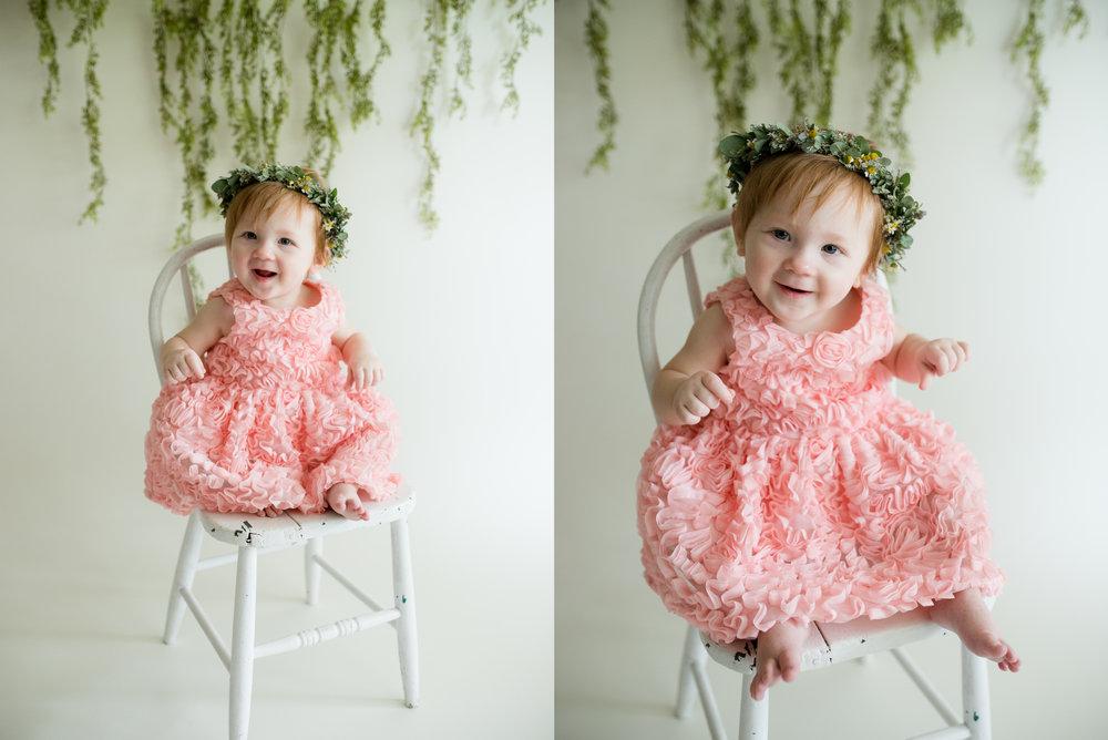 Baby girl sitting on white chair during one year photo session in Iowa.