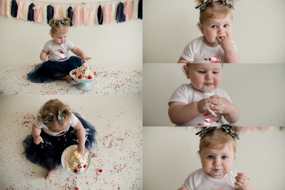 Baby girl eating ice cream while sitting on the floor during a one year old photoshoot in Iowa.