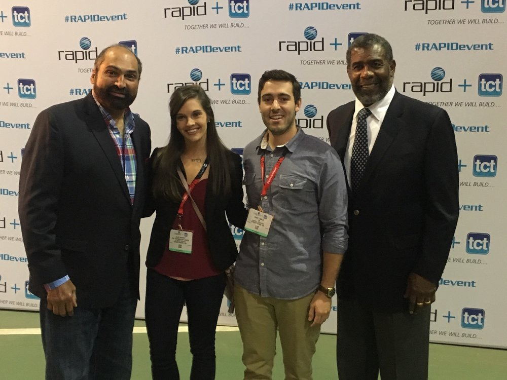 Photo taken at the Rapid 2017 tradeshow in Pittsburgh, PA. Left to right: Franco Harris (retired Steelers player), Julie Shontz, Owen Timlin (Sales at TTH), and Joe Green (retired Steelers players).