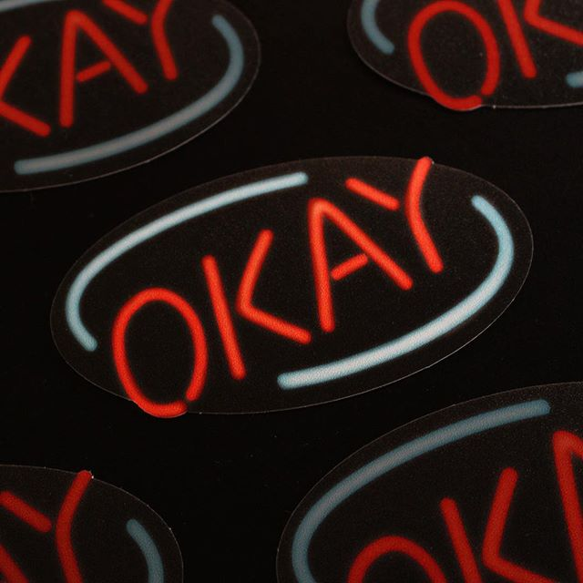 OKAY 🔺🔹 Hot off the press and looking fresh, embossed stickies- design by @wilfrid.art . . #neon #okay #stickers #nospaceissafe #dicut #spacevinyl