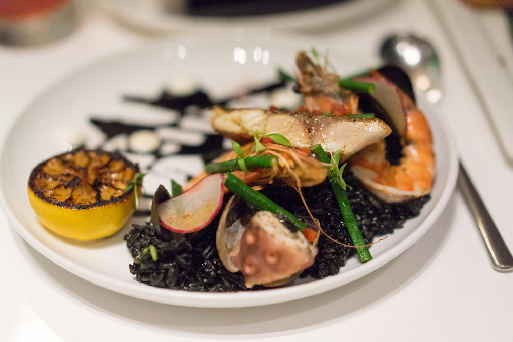 'Ele 'Ele $28 - Pacific Waters Seafood (Shrimp, Octopus, Clams, Mussels and the fish of the day), Calamari Ink, Rice, Cucumber Dill Yogurt.
