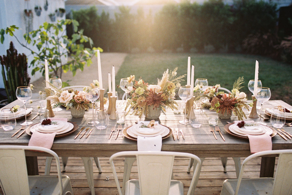 All photos of the 100 Layer Cake dinner party seen on our site were taken by the incredible  Caroline Yoon Photography .