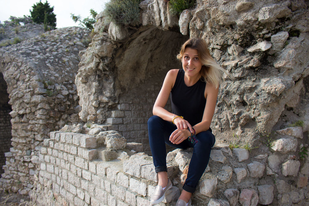 A Roman arena in Nice, France sets the stage for Anne to show off her new casual travel shoes.