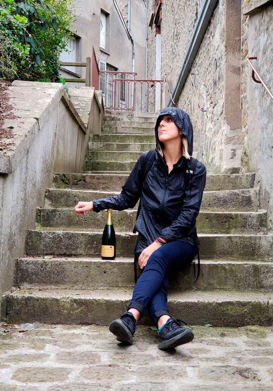 A lightweight windbreaker doubles as a rain shield when shopping for wine in France - Go Squab