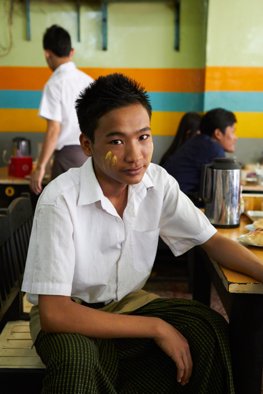 A boy wears thanaka