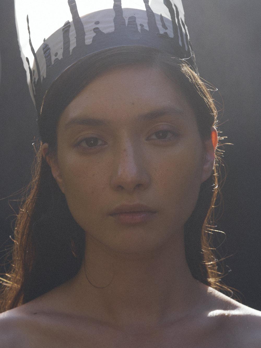 Noemi by Kristin Vicari wearing Camp Fire Glow Serum on the cheeks. Beauty and crown by Khandiz Joni