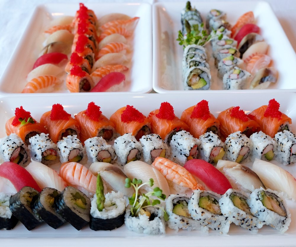 Sushi & Nigiri Combo $162 - Sushi Combo - Rolls (62 pieces)3 salmon lover rolls3 california rolls2 shrimp tempura rolls2 green vegetable rollsNigiri Combo (30 pieces)5 salmon5 tuna5 shrimp5 white fish5 yellowtail5sabaTotal of 92 pieces- served with ginger, wasabi and soy sauce