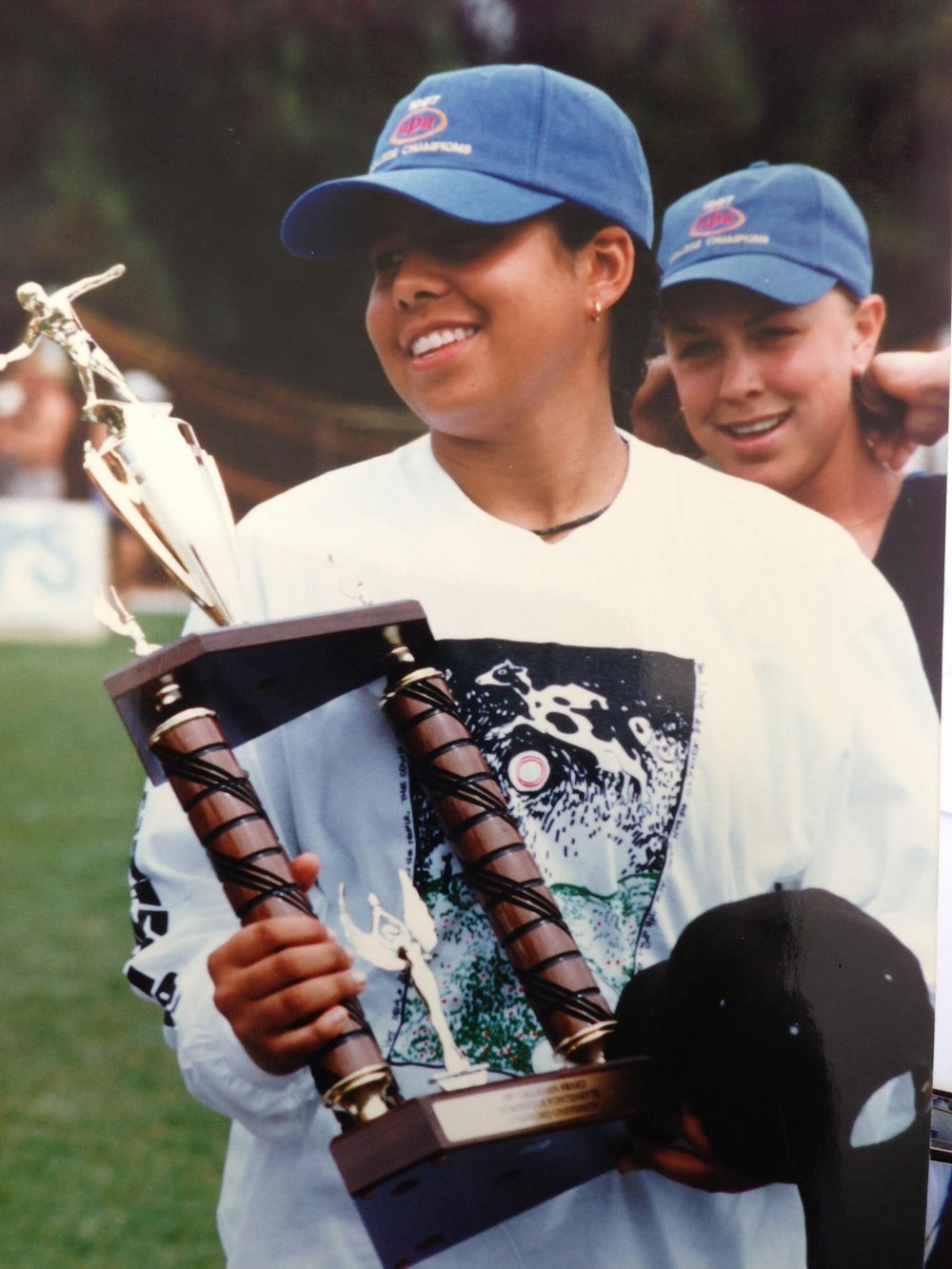 Left with Riot at Nationals, (Christina Schmidt, UltiPhotos).  Above winning the Callahan award at College Nationals with Stanford Superfly, 1997.