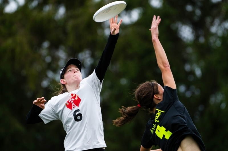 "Sarah ""Surge"" Griffith of Seattle Riot grabs the disc over Lien Hoffman of Boston Brute Squad at 2016 USAU Club Nationals (Jeff Bell, UltiPhotos)"