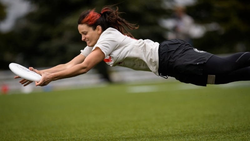 Hannah Baranes of Boston Slow White lays out for a catch at 2016 Club Nationals. (Paul Andris, UltiPhotos)