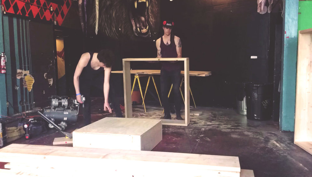Salo and David constructing set pieces for  I Want to Hear the Sea