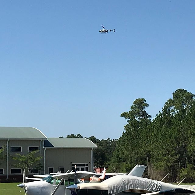 A routine stop turned into a manhunt today over here by Ferguson Airport.  The guy was pulled over, then took off into the woods on foot between Blue Angel and Dog Track. Sheriff's department used search dogs and a FWC helicopter to find the runner and we believe they were successful in apprehending him.  #neveradullmoment
