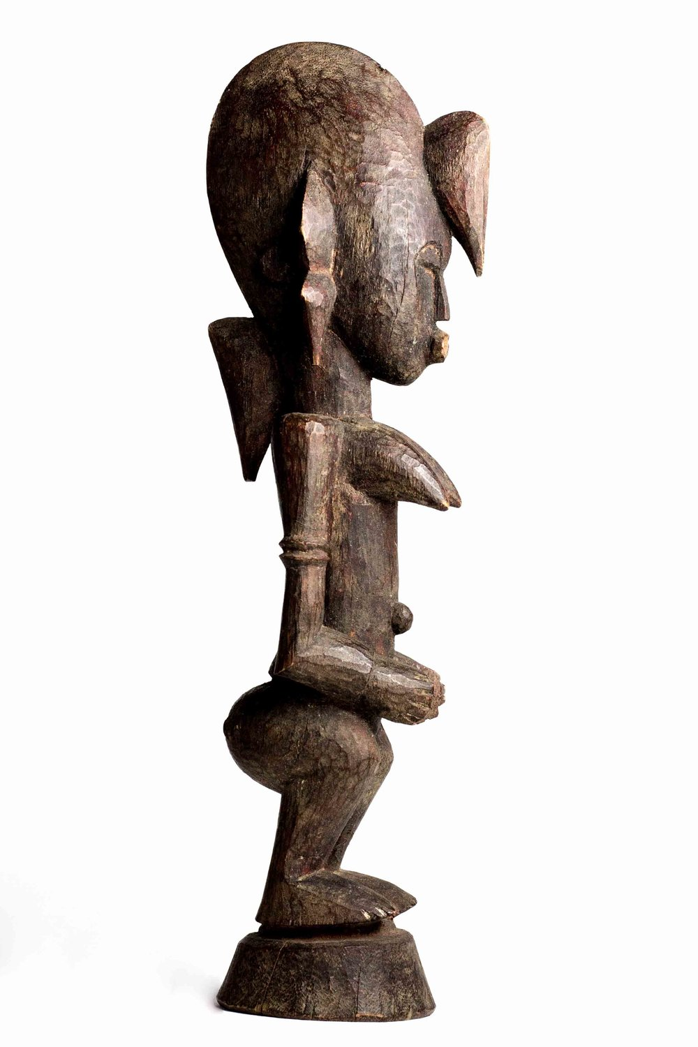 - Female figure collected 1976 in Kounoumon (Region of Boundiali, Côte d'Ivoire). It was carved 1970 by Kolotielema Dagnogo. The owner was a Balafon player Sedion Chomman. Wood with red coloring, remains of Kola nut offering on the mouth, H. 26 cm