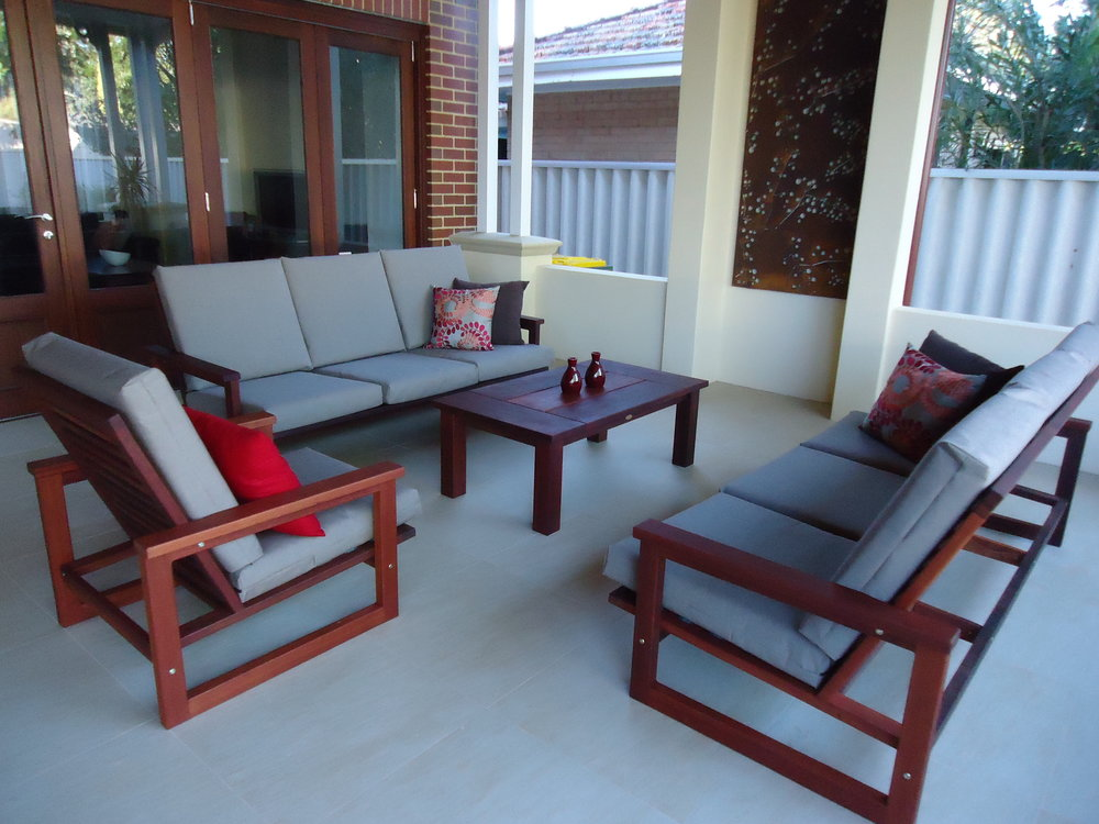 q1- Lisa outdoor lounge set with two three seat sofas and a single chair.JPG
