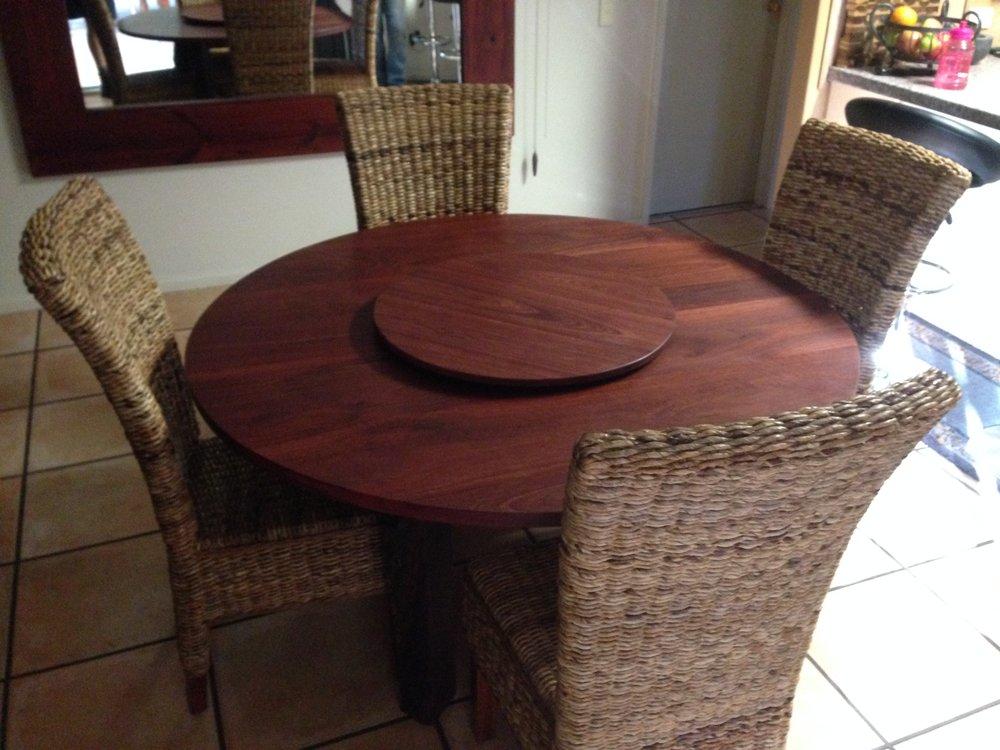 Custom Jarrah round dining table with natural edge legs.jpg