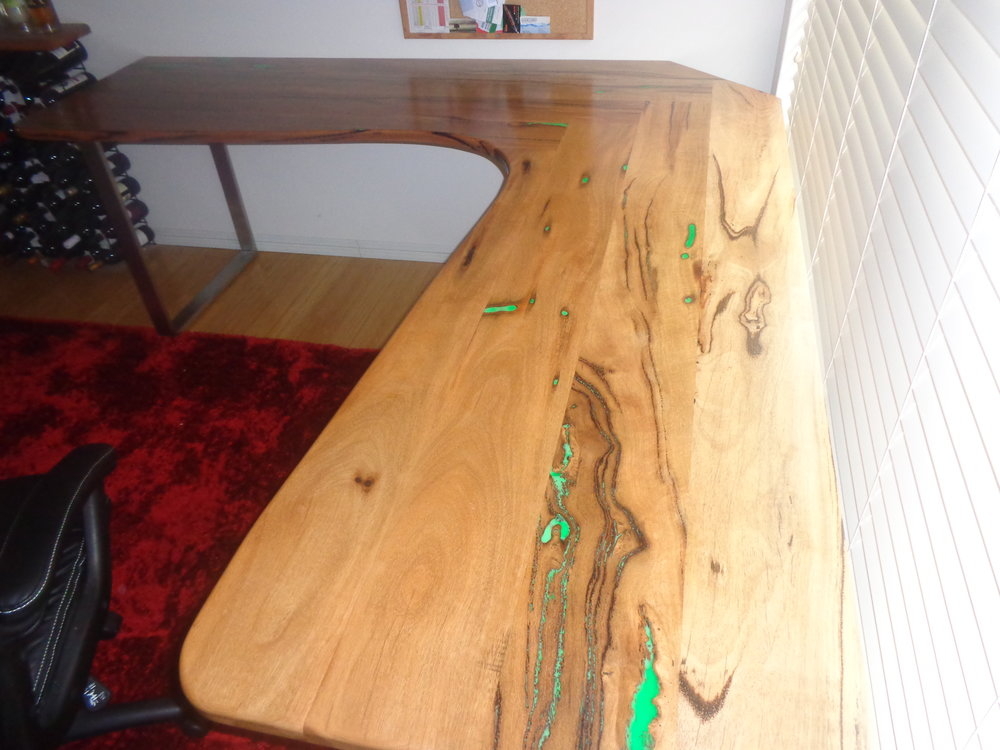 Marri desk with glow in the dark resin