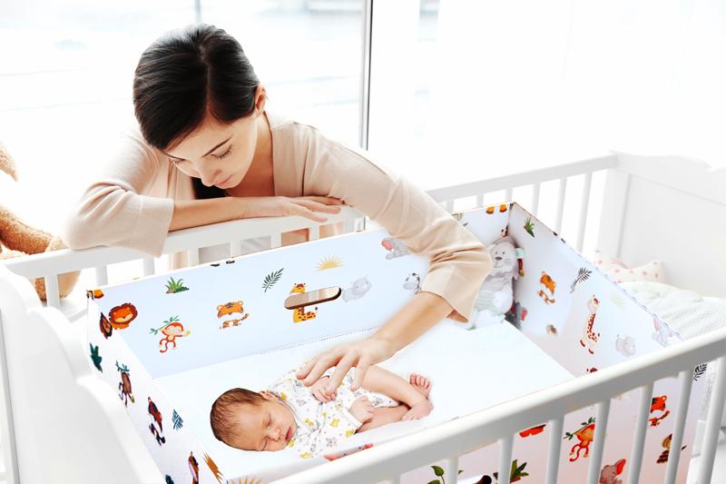 baby sleeping inside dream baby box, finnish baby box uk