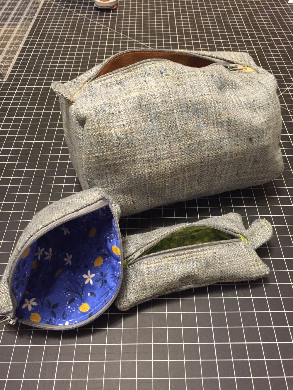 Handmade zippered pouches and totes.