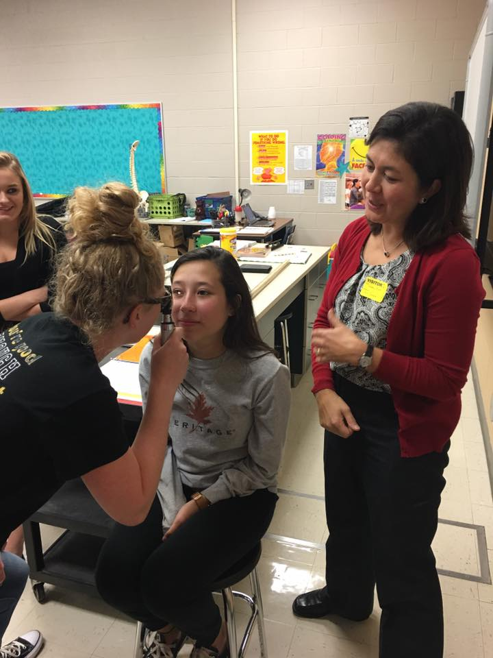 Medical students learn how to properly perform eye exams.