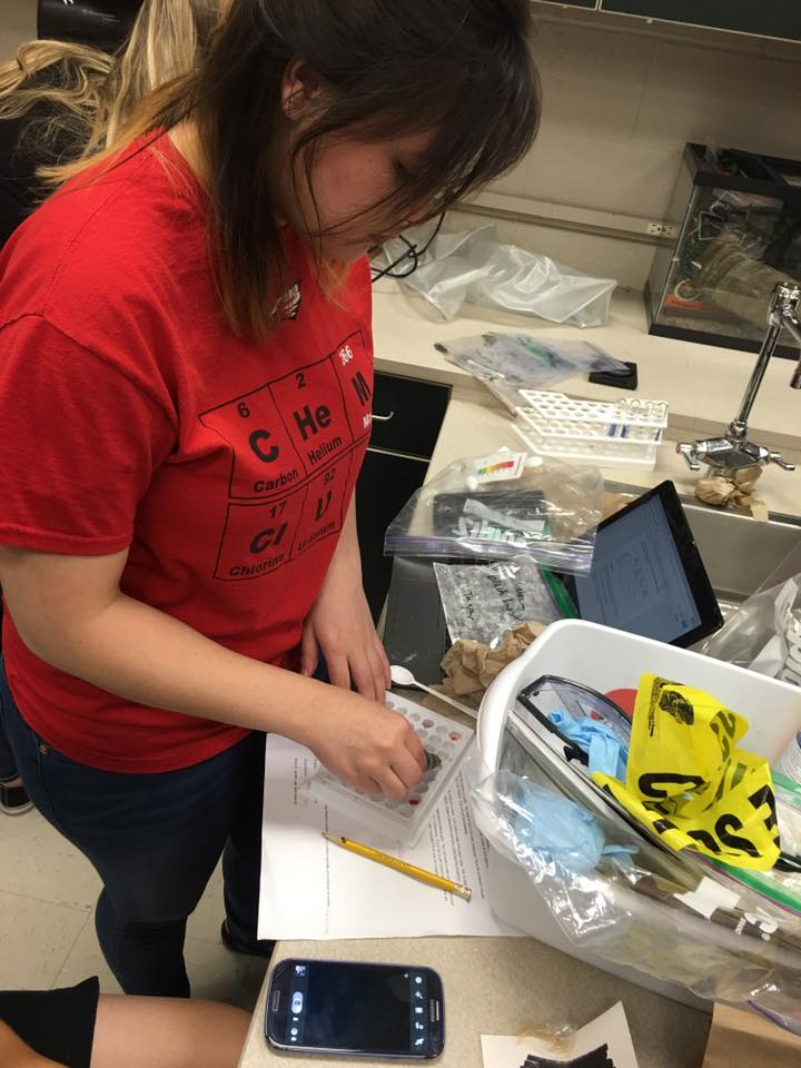 Science student working on her lab project.