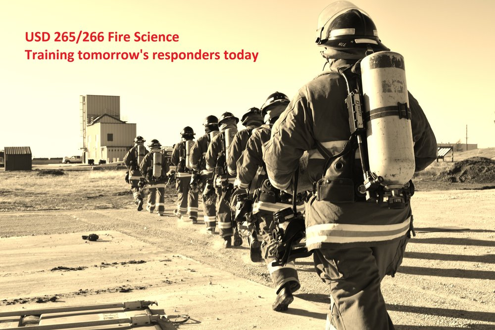 Fire Science students walking towards practice facility.