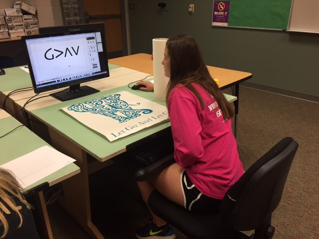 Graphic Design student works on her design.