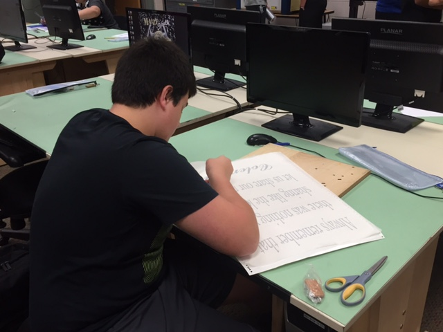 Graphic Design student works on his project.