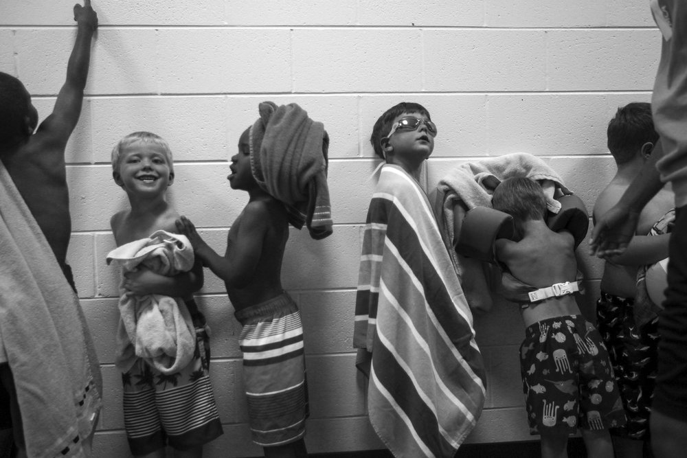 Kids wait in line before swimming during summer camp at the Purks YMCA in Vicksburg, Miss. June 9, 2017.  (Courtland Wells/The Vicksburg Post)