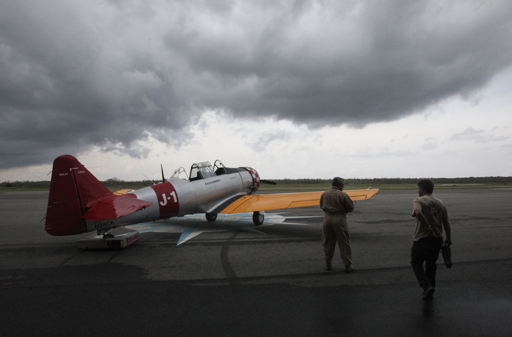 Dan Fordice taxis out a 1943 AT-6 Texan WWII Trainer plane for rides during Spring Is In The Air Day at the Southern Heritage Air Foundation Museum Hanger on Saturday. SHAF hosted the event featuring all you can eat crawfish, plane rides and free museum tours.  (Courtland Wells/Vicksburg Post)